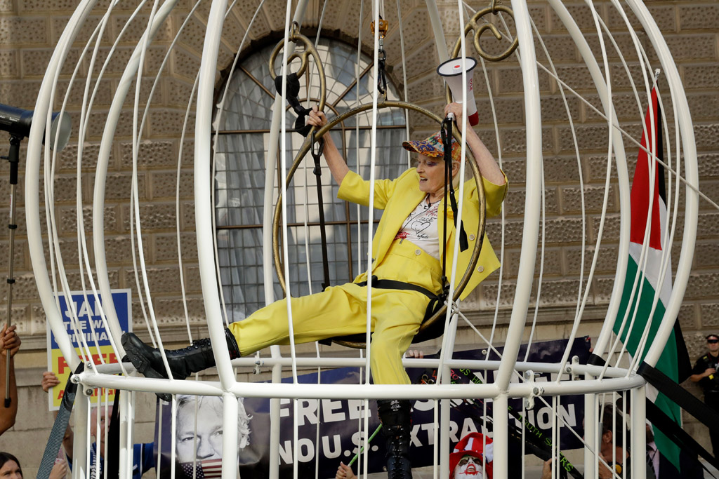 vivienne westwood, protest, julian assange, bird cage, yellow