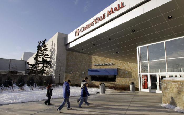 Shoppers walk into the CherryVale Mall Friday, Dec. 8, 2006 in Rockford, Ill. where federal authorities said a Muslim convert planned to wage jihad against civilians by setting off hand grenades in garbage cans during the Christmas rush. Investigators said the suspect Derrick Shareef, 22, of Rockford, was acting alone and never actually obtained any grenades. (AP Photo/M. Spencer Green)