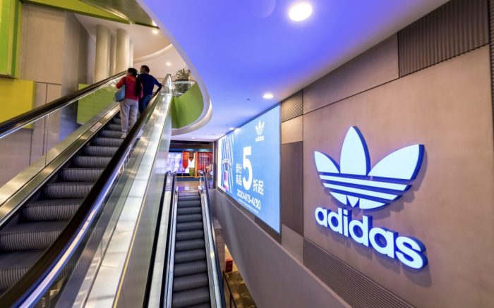 The exterior view of an Adidas store, which launches 50% off promotion to attract customers, Shanghai, China, 24 April 2020.  (Imaginechina via AP Images)