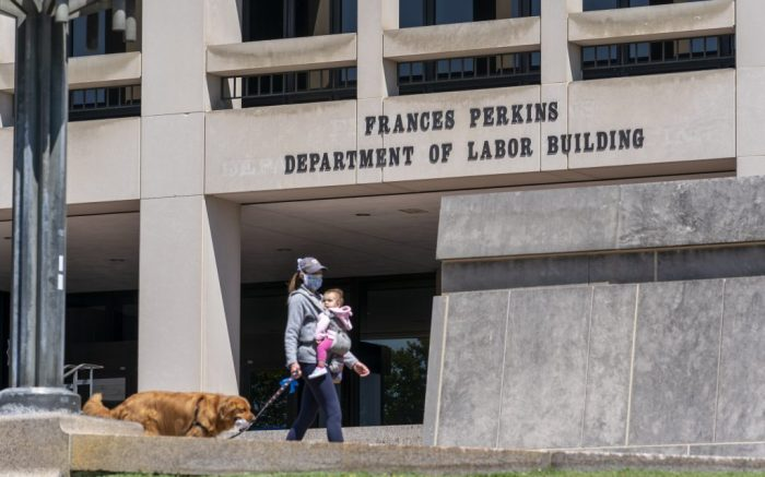The entrance to the Labor Department is seen near the Capitol in Washington, Thursday, May 7, 2020, as it prepares to release a new unemployment report tomorrow. Nearly 3.2 million laid-off workers applied for unemployment benefits last week as business shutdowns caused by the coronavirus pandemic deepened, resulting in the worst U.S. economic catastrophe in decades. (AP Photo/J. Scott Applewhite)