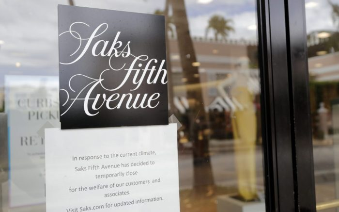 A Saks Fifth Avenue store remains closed on Worth Ave. during the new coronavirus pandemic, Monday, May 11, 2020, in Palm Beach, Fla. Palm Beach County was authorized by Florida Gov. Ron DeSantis to initiate Phase 1 reopening regulations Monday, which includes limited reopening of retail establishments. (AP Photo/Lynne Sladky)