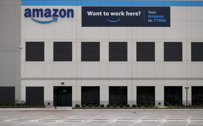 A newly constructed Amazon fulfillment facility has a banner on it advertising that it is hiring in Dallas, Wednesday, May 20, 2020. Amazon has begun hiring for positions at the facility. (AP Photo/Tony Gutierrez)