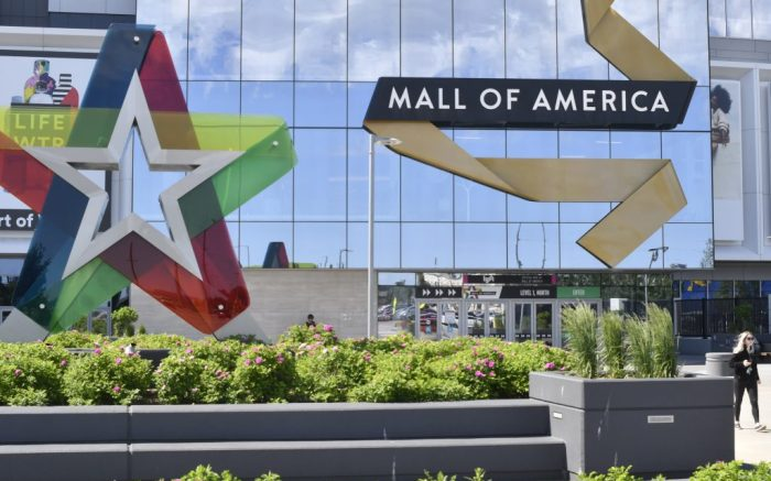 A visitor leaves the Mall of America, Thursday, June 11, 2020 in Bloomington, Minnesota. The mall reopened Wednesday after being closed since March due to the coronavirus. (AP Photo/Jim Mone)