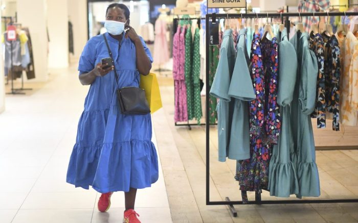 Coronavirus - Fri Jul 24, 2020. A woman wears a mask as she walks through Selfridges in London as face coverings become mandatory in shops and supermarkets in England. Picture date: Friday July 24, 2020. See PA story HEALTH Coronavirus. Photo credit should read: Victoria Jones/PA Wire URN:54716131 (Press Association via AP Images)