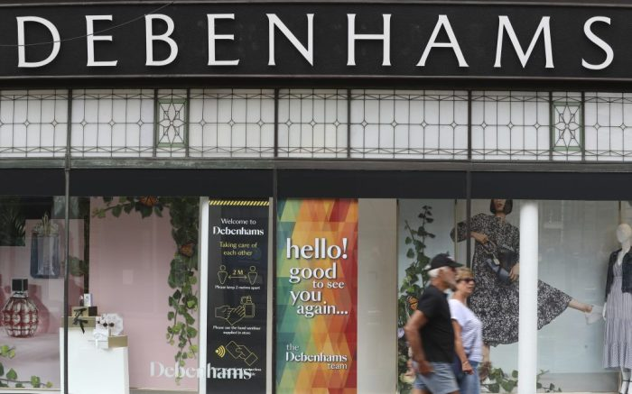 "Debenhams financials. File photo dated 14/6/2020 of people walk past Debenhams department store on the High street in Winchester. Liquidation plans are being drawn up for Debenhams in case other options for saving the department store chain fail, potentially threatening thousands of jobs. Issue date: Saturday August 15, 2020. It is understood restructuring firm Hilco Capital has been appointed to work on ""contingency plans"" with the retailer in the event that a sales process for the well-known British high street brand fails. See PA story CITY Debenhams. Photo credit should read: Andrew Matthews/PA Wire URN:55011051 (Press Association via AP Images)"