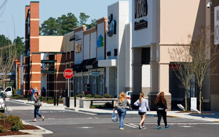 Advocate staff photo by SCOTT THRELKELD --  Shoppers head to open stores Thursday, March 13, 2014,  Fremaux Town Center in Slidell. The grand opening for the center is Friday.