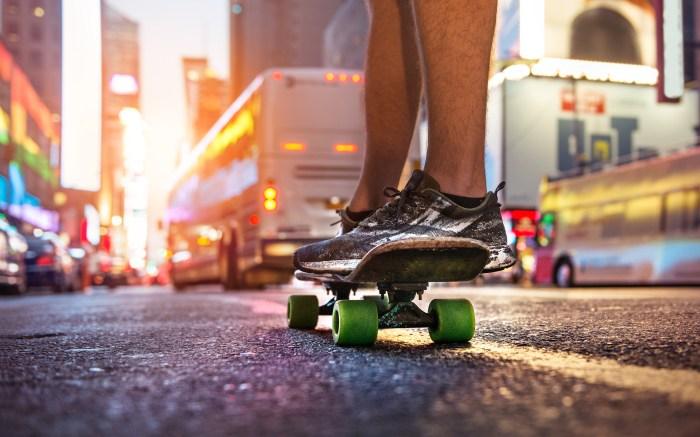 Man enjoy the riding on skateboard on city street at sunset time. Skateboarder people sport concept theme.