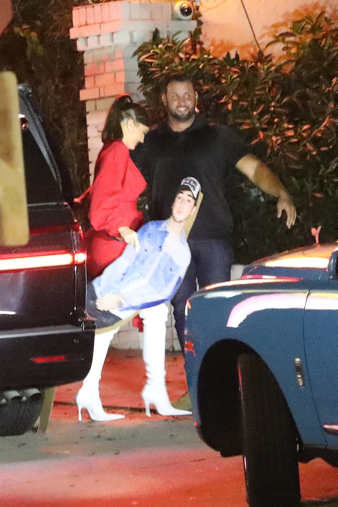 EXCLUSIVE: Kylie Jenner carries a cardboard cutout of best friend Zack Bia as she and Zack head to the Chateau Marmont to party till 3 A.M. in West Hollywood. Kylie Jenner is wearing long white boots and a red one piece dress which showcases her curves. 21 Aug 2020 Pictured: Kylie Jenner. Photo credit: MEGA TheMegaAgency.com +1 888 505 6342 (Mega Agency TagID: MEGA695380_001.jpg) [Photo via Mega Agency]