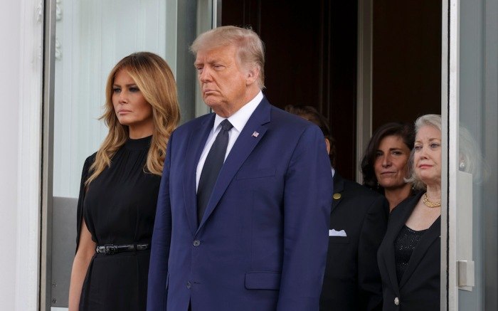 United States President Donald J. Trump and First Lady Melania Trump wait as pallbearers carry the casket of Robert Trump after a service at the White House in Washington, DC on Friday, August 21, 2020. Credit: Tasos Katopodis / Pool via CNP. 21 Aug 2020 Pictured: United States President Donald J. Trump and First Lady Melania Trump wait as pallbearers carry the casket of Robert Trump after a service at the White House in Washington, DC on Friday, August 21, 2020. Credit: Tasos Katopodis / Pool via CNP. Photo credit: Tasos Katopodis - Pool via CNP / MEGA TheMegaAgency.com +1 888 505 6342 (Mega Agency TagID: MEGA695440_013.jpg) [Photo via Mega Agency]