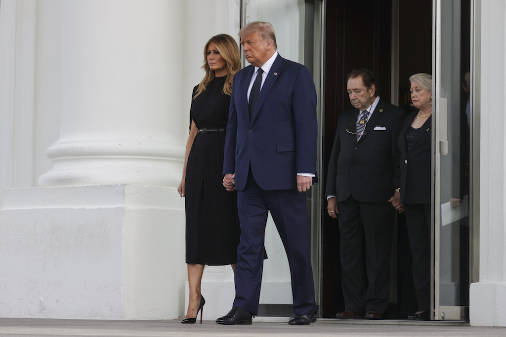 United States President Donald J. Trump and First Lady Melania Trump wait as pallbearers carry the casket of Robert Trump after a service at the White House in Washington, DC on Friday, August 21, 2020. Credit: Tasos Katopodis / Pool via CNP. 21 Aug 2020 Pictured: United States President Donald J. Trump and First Lady Melania Trump wait as pallbearers carry the casket of Robert Trump after a service at the White House in Washington, DC on Friday, August 21, 2020. Credit: Tasos Katopodis / Pool via CNP. Photo credit: Tasos Katopodis - Pool via CNP / MEGA TheMegaAgency.com +1 888 505 6342 (Mega Agency TagID: MEGA695440_010.jpg) [Photo via Mega Agency]
