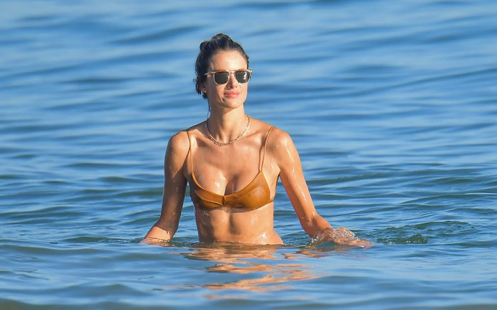 Alessandra Ambrosio spends a fun day at the beach playing volleyball and taking a dip in the ocean in Malibu