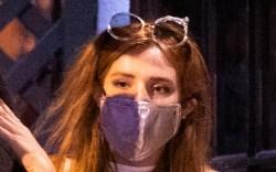 bella thorne, mask, glasses, sweatshirt, sweatpants,