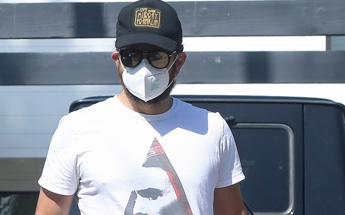 Bradley Cooper keeps it safe with a mask on while out and about