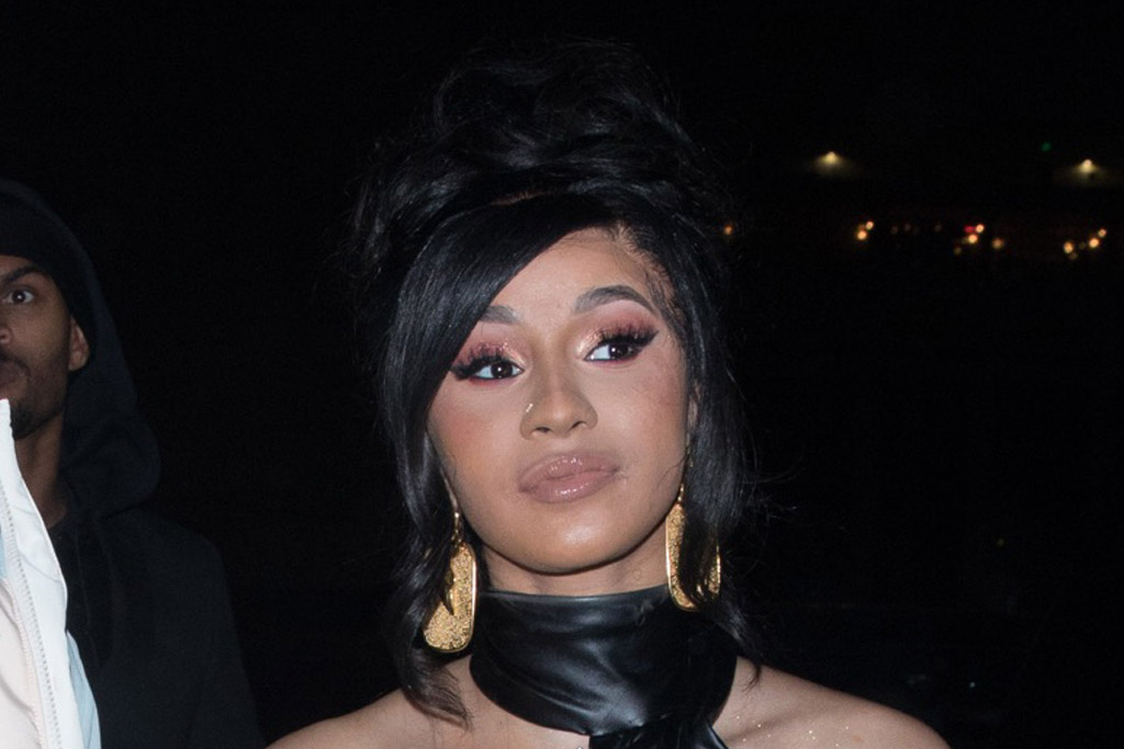 Cardi B Accents Her Peek-a-Boo Dress With Sheer Thigh-High Stockings & Classic Pumps