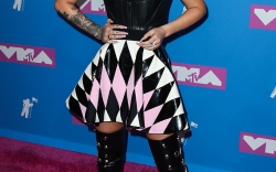 Iggy Azalea wearing a Fausto Puglisi dress arrives at the 2018 MTV Video Music Awards