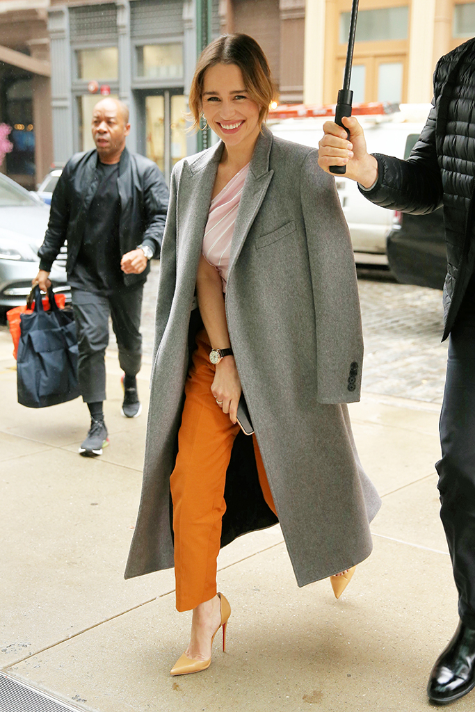 Actress Emilia Clarke Is Seen Wearing Rust Pants, Pink Striped Blouse And Grey Overcoat In New York CityPictured: Emilia ClarkeRef: SPL5125162 291019 NON-EXCLUSIVEPicture by: Christopher Peterson / SplashNews.comSplash News and PicturesUSA: +1 310-525-5808London: +44 (0)20 8126 1009Berlin: +49 175 3764 166photodesk@splashnews.comWorld Rights