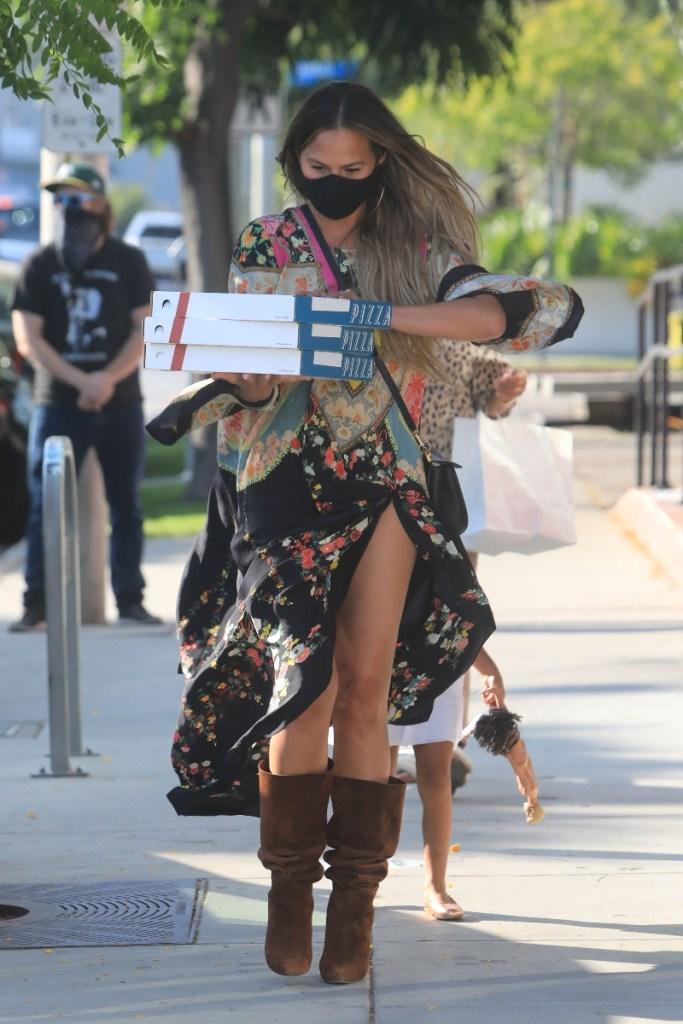 chrissy teigen, dress, floral, boots, brown, suede, saint laurent, pizza, style