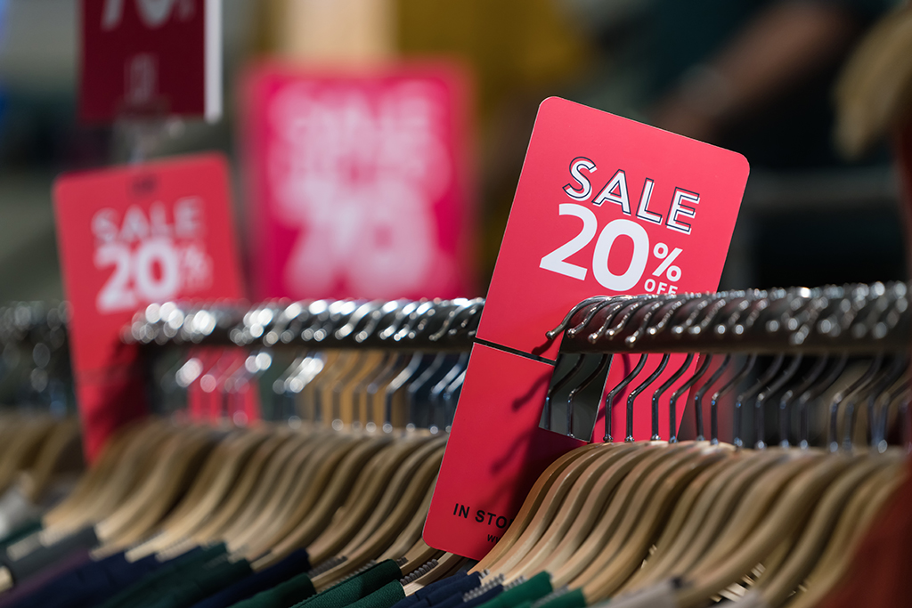 20% sale off red and white sign. Discount sale banner at cloth bar store.
