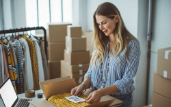 Women, owner of small business packing