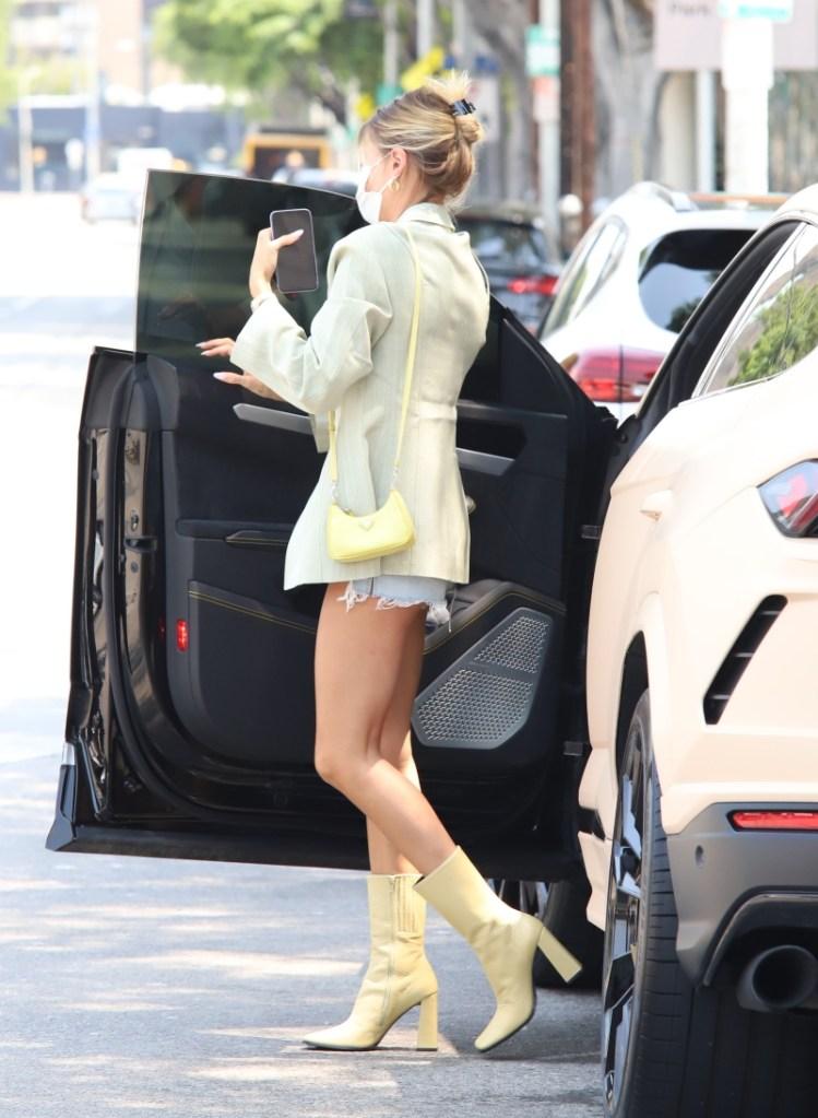 hailey baldwin, yellow boots, jean shorts, blazer, green blazer, bag, prada, mask, los angeles