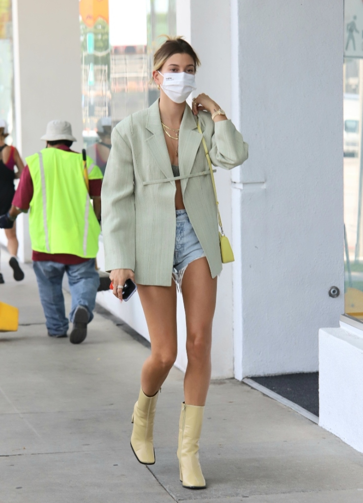 hailey baldwin, yellow boots, jean shorts, blazer, green blazer, bag, prada, mask, los angeles