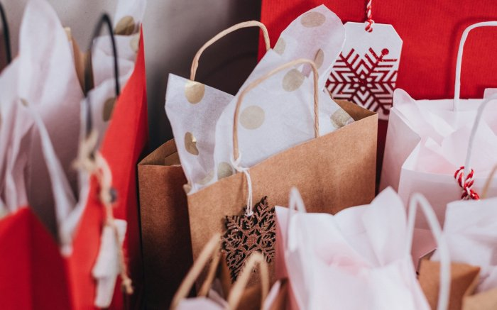 Holiday gifts in bags with wrapping
