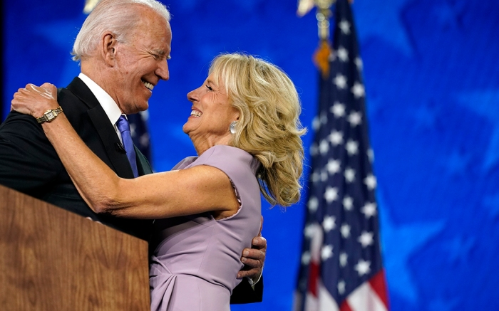 Democratic presidential candidate former Vice President Joe Biden hugs his wife Jill Biden after speaking during the fourth day of the Democratic National Convention, Thursday, Aug. 20, 2020, at the Chase Center in Wilmington, Del. (AP Photo/Andrew Harnik)