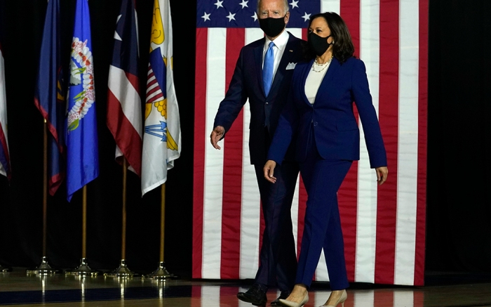 Democratic presidential candidate former Vice President Joe Biden and his running mate Sen. Kamala Harris, D-Calif., arrive to speak at a news conference at Alexis Dupont High School in Wilmington, Del., Wednesday, Aug., 12, 2020. (AP Photo/Carolyn Kaster)