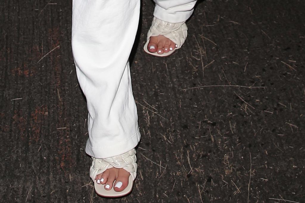 kylie jenner, white, bralette, sweats, sandals, bottega veneta