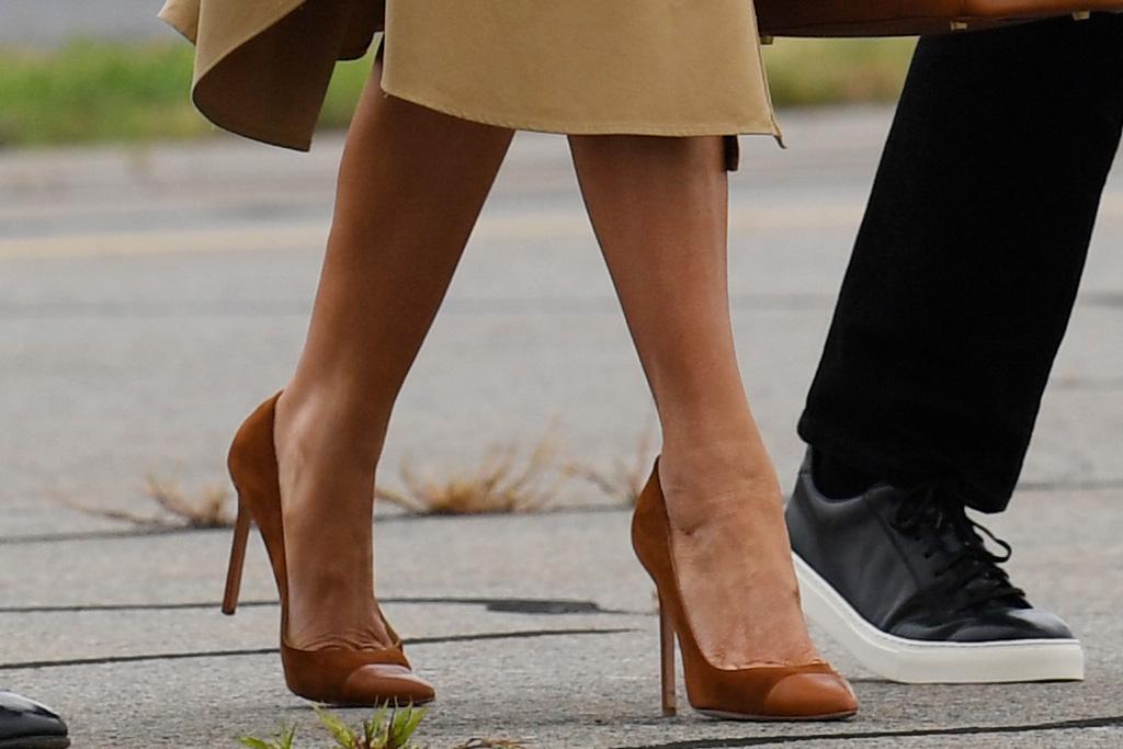melania trump, brown dress, dress, pumps, heels, air force 1, donald trump, barron trump, jacket, t-shirt, pants, sneakers, style
