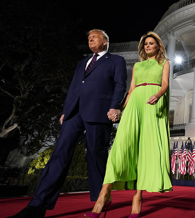 lime green dress, valentino, President Donald Trump and first lady Melania Trump arrive for his acceptance speech to the Republican National Committee Convention on the South Lawn of the White House, Thursday, Aug. 27, 2020, in Washington. (AP Photo/Evan Vucci)