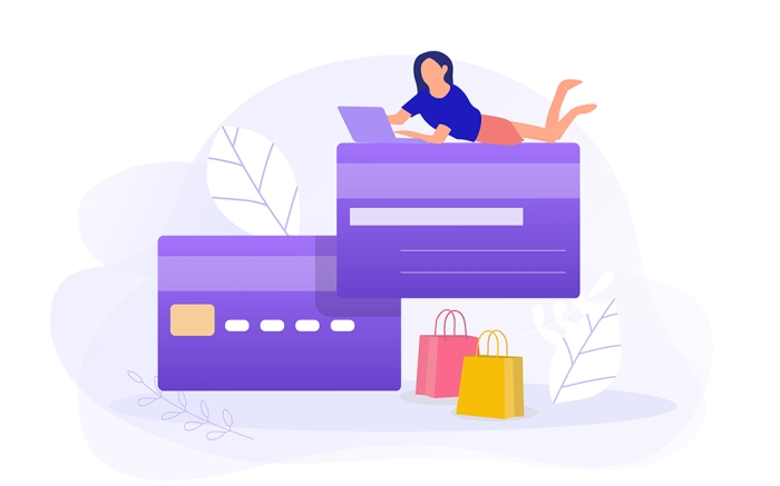 Woman with laptop makes online shopping on a big credit card Credit card icon.