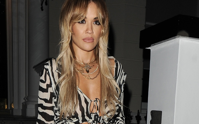 Rita Ora leaving her home, to attend her friends 30th birthday party. Rita wore a zebra print crop top, with blue jeans
