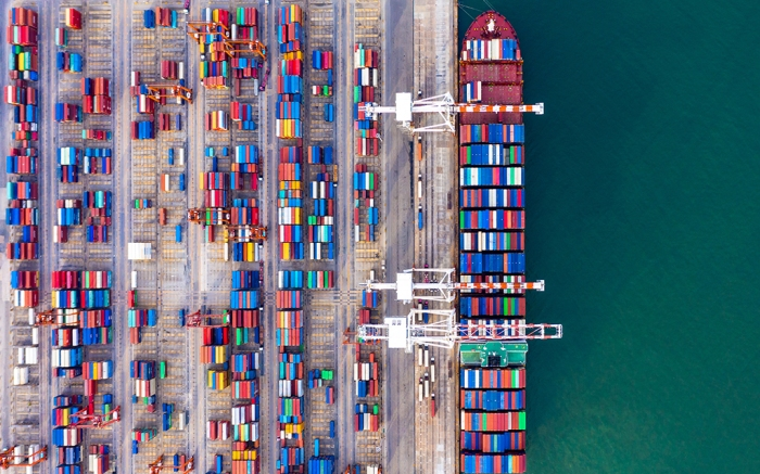 Container ship unloading in deep sea port, Global business logistic import export freight shipping transportation oversea worldwide by container ship in open sea, Container vessel loading cargo freight ship.
