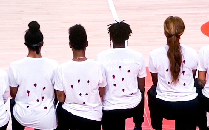 August 26, 2020, Bradenton, Florida, USA - A screen grab from the ESPN2 coverage of the decision made by the six WNBA teams not to play tonight in the wake of the shooting of yet another Black man in America. The Washington Mystics donned t shirts spelling out the name of Jacob Blake, who was shot seven times in the back by a white Kenosha, Wisconsin policeman. Seven holes were cut out of the backs of their shirts, depictions of the seven bullet holes in Mr. Blake's back. All of tonight's NBA playoff games were also postponed.(Credit Image: © Courtesy Espn2/ZUMA Wire) (Cal Sport Media via AP Images)
