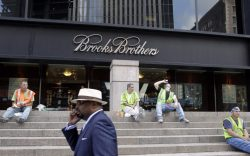 A man passes a Brooks Brothers