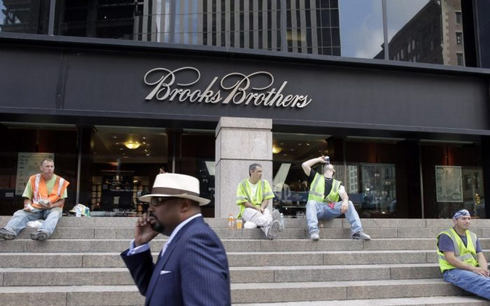 A man passes a Brooks Brothers store on Church St. in lower Manhattan, Aug. 4, 2011 in New York. The store is across the street from the World Trade Center and was heavily damaged on Sept. 11, 2001. (AP Photo/Mark Lennihan)