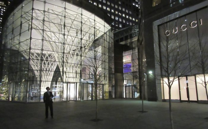 FILE - In this Nov. 30, 2015, file photo, a passer-by walks past the exterior of Brookfield Place, an upscale mall in Lower Manhattan at the World Financial Center in New York. Brookfield Property is offering to buy remaining stake in mall owner GGP that it doesn't already own for more than $14 billion. GGP said Monday, Nov. 13, 2017, that a special committee will review the unsolicited proposal. (AP Photo/Beth J. Harpaz, File)