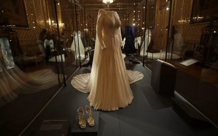 The wedding evening gown of Britain's Princess Eugenie, by American designer Zac Posen, is displayed during a media preview at Windsor Castle in Windsor, near London, England, Thursday, Feb. 28, 2019. The couples' wedding outfits are going on display as part of an exhibition at the castle running from March 1 until April 22. (AP Photo/Matt Dunham)
