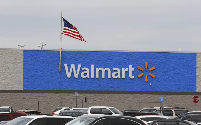 Signage is pictured at a Walmart store Tuesday, Aug. 4, 2020, in Oklahoma City. (AP Photo/Sue Ogrocki)