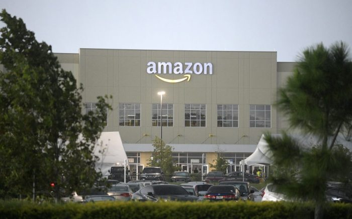 The Amazon Lake Nona Fulfillment Center is viewed, Sunday, Aug. 9, 2020, in Orlando, Fla. Many beaches and businesses have reopened during the new coronavirus pandemic. (Phelan M. Ebenhack via AP)