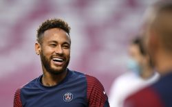 PSG's Neymar smiles during a training