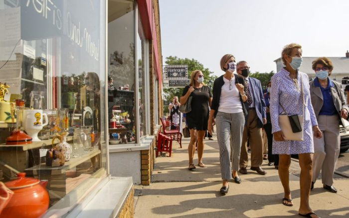 Gov. Kim Reynolds, center, reacts to seeing the damage and reconstruction efforts at Cafe Saint Pio during a tour of small businesses in the Czech Village neighborhood affected by the Aug. 10 derecho storm, Tuesday, Aug. 25, 2020, in Cedar Rapids, Iowa. (Andy Abeyta/The Gazette via AP)