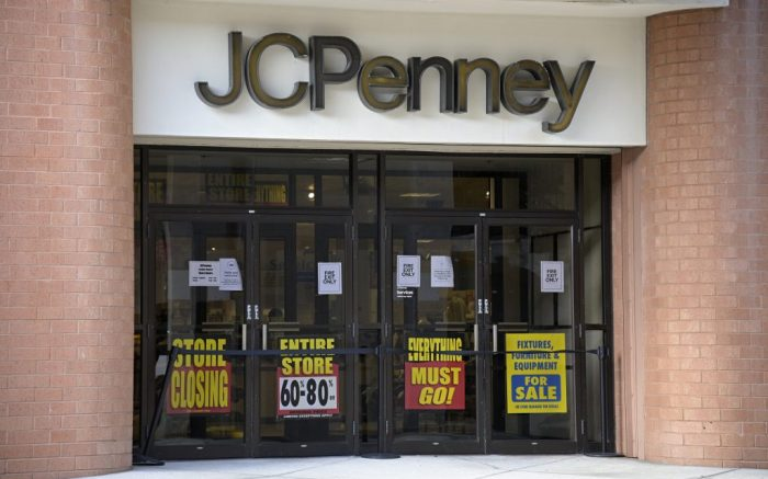 Signs are viewed at an entrance to a JCPenney store that is slated to be closed down, Thursday, Sept. 3, 2020, in Orlando, Fla. Many schools and businesses have reopened during the new coronavirus pandemic. (Phelan M. Ebenhack via AP)