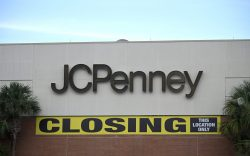 A store closing sign is viewed