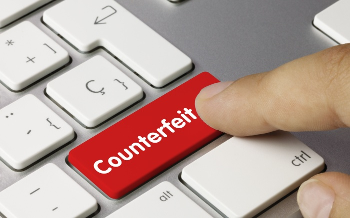Counterfeit button on a keyboard for e-commerce