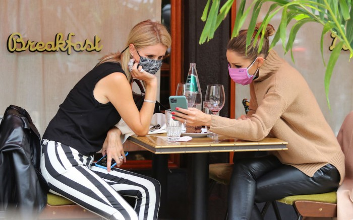 "Nicky Hilton and Olivia Palermo make the streets of Soho look super stylish after having lunch together at ""Sant Ambroeus"" restaurant in Downtown Manhattan. 16 Sep 2020 Pictured: Nicky Hilton and Olivia Palermo. Photo credit: LRNYC / MEGA TheMegaAgency.com +1 888 505 6342 (Mega Agency TagID: MEGA700883_002.jpg) [Photo via Mega Agency]"