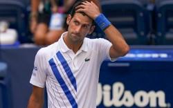 Novak Djokovic, of Serbia, reacts after