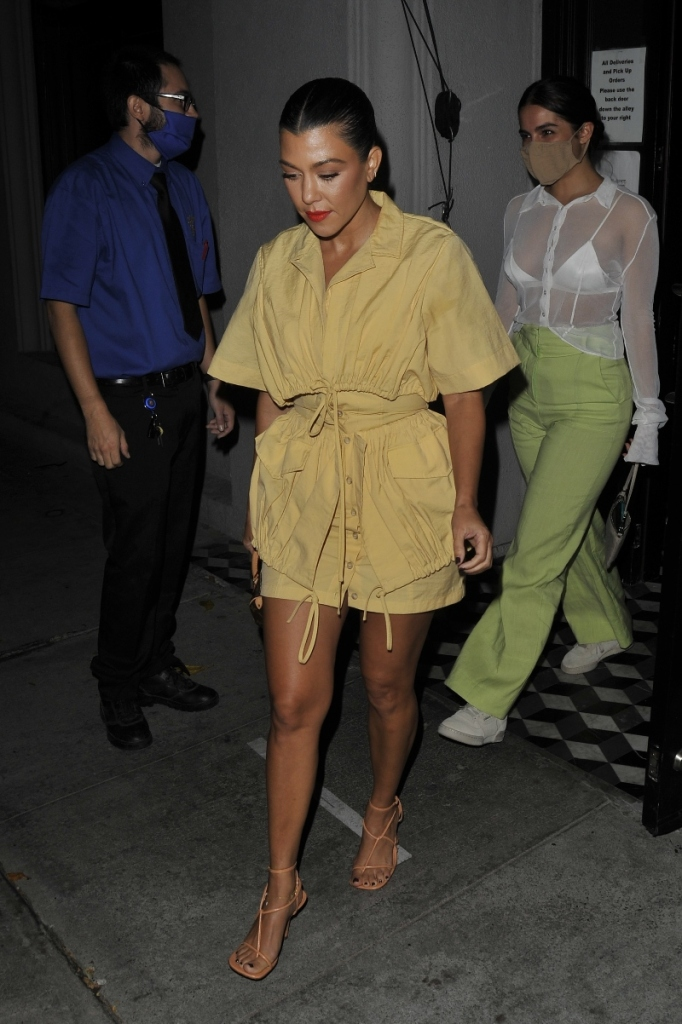 kourtney kardashian, yellow, romper, sandals, bottega veneta, addison rae, sheer shirt, pants, green, bra, sneakers, adidas