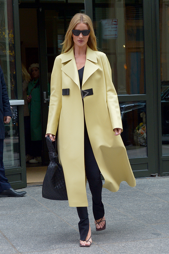 Rosie Huntington-Whiteley in a yellow long coat checks out of her Manhattan hotel on Sunday, November 10th, 2019.Pictured: Rosie Huntington-WhiteleyRef: SPL5127961 101119 NON-EXCLUSIVEPicture by: Luis Yllanes / SplashNews.comSplash News and PicturesUSA: +1 310-525-5808London: +44 (0)20 8126 1009Berlin: +49 175 3764 166photodesk@splashnews.comWorld Rights